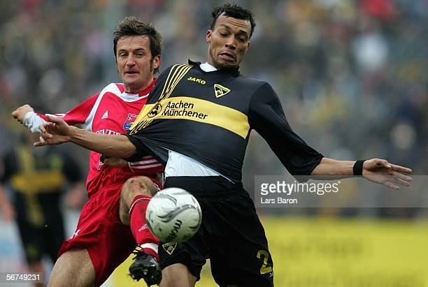 Thomas Sobotzik of Unterhaching challenges Emil Noll of Aachen for the ball during the Second Bundesliga match between Alemannia Aachen and Spvgg...