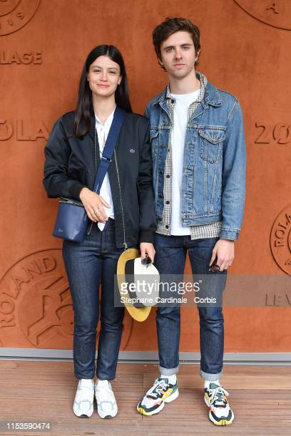 Thomas Soliveres and Lucie Boujenah attend the 2019 French Tennis Open - Day Eight at Roland Garros on June 03, 2019 in Paris, France.