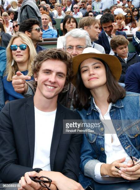 Thomas Soliveres Michel Boujenah and his niece Lucie Boujenah attend the 2018 French Open Day Three at Roland Garros on May 29 2018 in Paris France