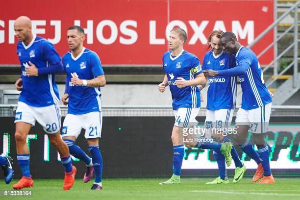 Thomas Sorensen Kristoffer Larsen and Kim Ojo of Lyngby BK celebrate after scoring their first goal during the Danish Alka Superliga match between...