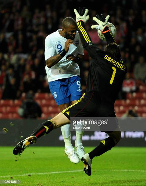 Thomas Sorensen of Denmark blocks the attempt on goal of Darren Bent of England during the International Friendly match between Denmark and England...