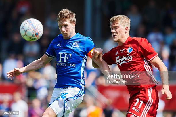 Thomas Sorensen of Lyngby BK and Andreas Cornelius of FC Copenhagen compete for the ball during the Danish Alka Superliga match between Lyngby BK and...