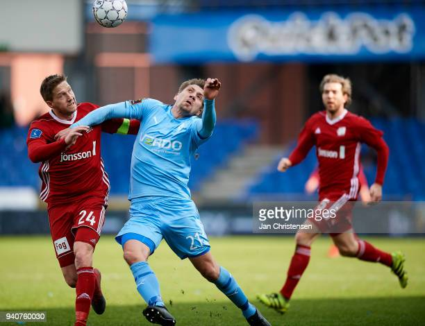 Thomas Sorensen of Lyngby BK and Mikael Boman of Randers FC compete for the ball during the Danish Alka Superliga match between Randers FC and Lyngby...