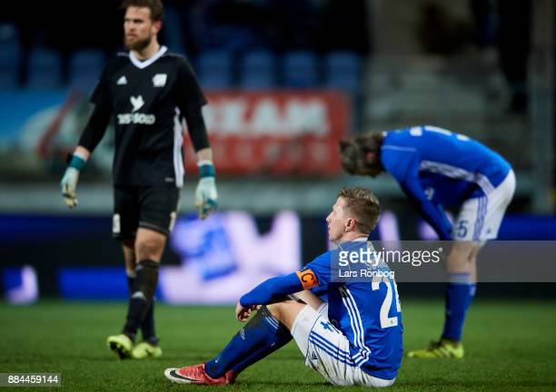 Thomas Sorensen of Lyngby BK sitting on the pitch dejected after the Danish Alka Superliga match between Lyngby BK and AaB Aalborg at Lyngby Stadion...