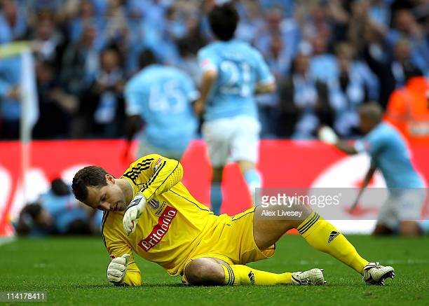 Thomas Sorensen of Stoke City looks dejected after Yaya Toure of Manchester City scored during the FA Cup sponsored by EON Final match between...