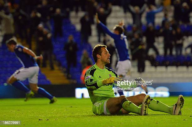 Thomas Sorensen of Stoke City sits on the pitch after Oliver Lee of Birmingham City scores their fourth goal in extra time during the Capital One Cup...