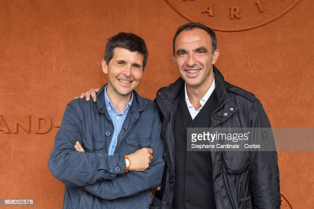 Thomas Sotto and Nikos Aliagas attend the 2018 French Open Day Ten at Roland Garros on June 5 2018 in Paris France