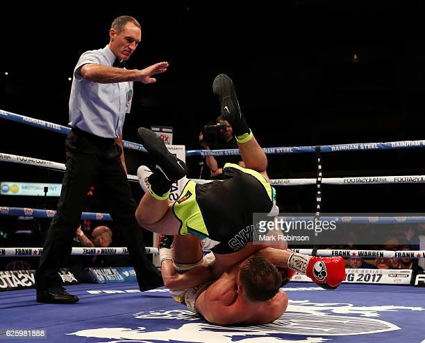 Thomas Stalker and Craig Evans both take tumble in the 10th Round during their WBO European lightweight title fight at the Motorpoint Arena on...