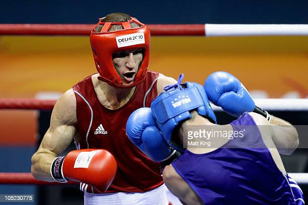 Thomas Stalker of England competes against Josh Taylor of Scotland in the Light Weight Men Finals Gold Medal Bout at Talkatora Indoor Stadium on day...