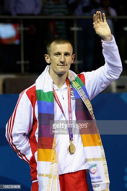 Thomas Stalker of England poses with the gold medal during the medal ceremony for the Light Weight Men Finals Gold Medal Bout at Talkatora Indoor...