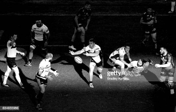 Thomas Staniforth of the Brumbies passes the ball during the Rugby Global Tens match between the Brumbies and Toulon at Suncorp Stadium on February...