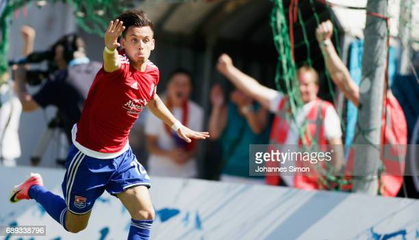 Thomas Steinherr of Unterhaching celebrates after scoring his team's 3rd goal during the third league playoff leg one match at Alenbauer Sportpark on...