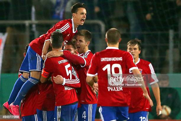 Thomas Steinherr of Unterhaching celebrates the second team goal with his team mates during the DFB Cup round two match between SpVgg Unterhaching...