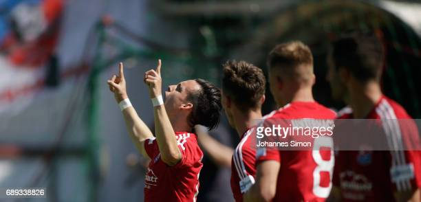 Thomas Steinherr of Unterhaching celebrates with team mates after scoring his team's 3rd goal during the third league playoff leg one match at...