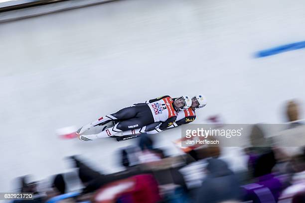 Thomas Steu and Lorenz Koller of Austria compete in the first heat of the Men's Double Luge competition during the second day of the FILWorld...