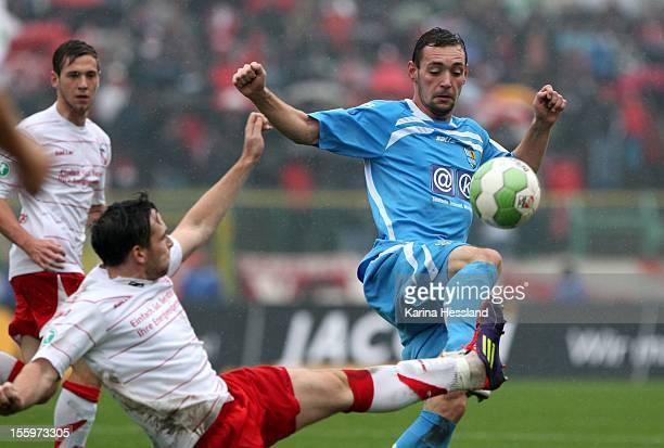 Thomas Stroehl of Erfurt challenges Maik Kegel of Chemnitz during the Third League match between RW Erfurt and Chemnitzer FC at Steigerwald Stadion...