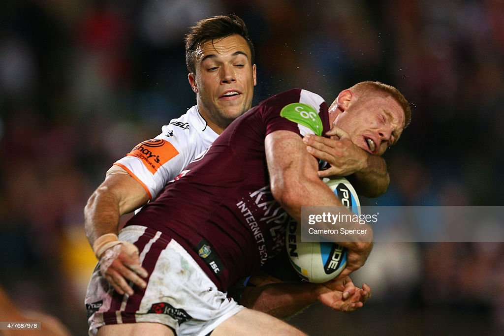 Thomas Symonds of the Sea Eagles is tackled during the round 15 NRL match between the Manly Sea Eagles and the Wests Tigers at Brookvale Oval on June 19, 2015 in Sydney, Australia.