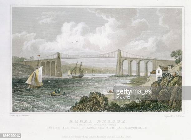 Thomas Telford's suspension bridge over Menai Straits, Wales, built 1820-1826. View from Angelsea side. Original timber deck wrecked in storm, 1839....