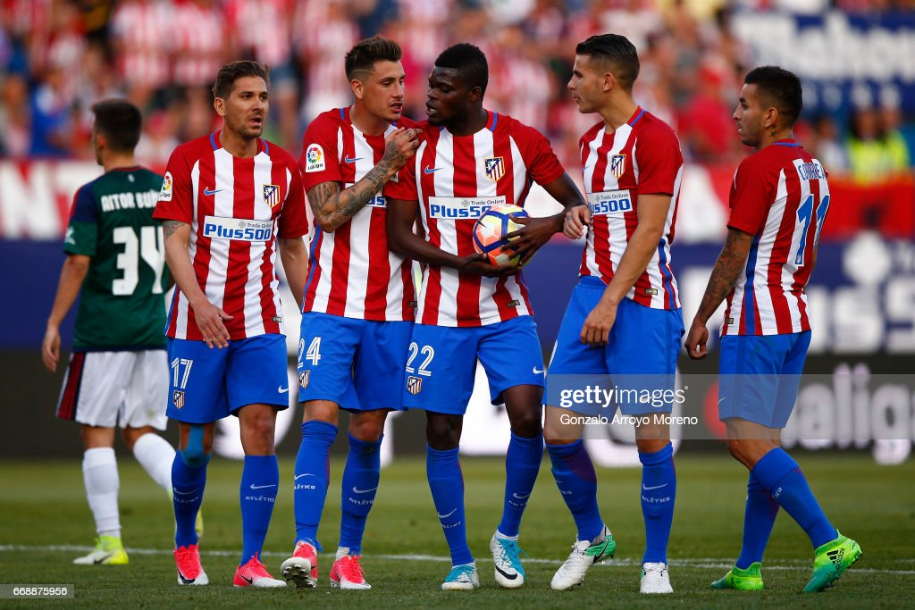 Thomas Teye Partey (3dR) of Atletico de Madrid argues with his teammates Jose Maria Gimenez (2ndL), Alessio Cerci (L), Lucas Hernandez (2ndR) and Angel Martin Correa (R) before taking a penalty shot during the La Liga match between Club Atletico de Madrid and CA Osasuna at Vicente Calderon Stadium on April 15, 2017 in Madrid, Spain.