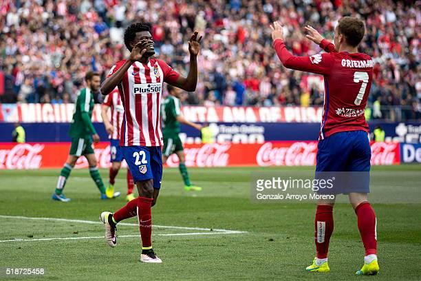 Thomas Teye Partey of Atletico de Madrid celebrates scoring their fifth goal with teammate Antoine Griezmann during the La Liga match between Club...
