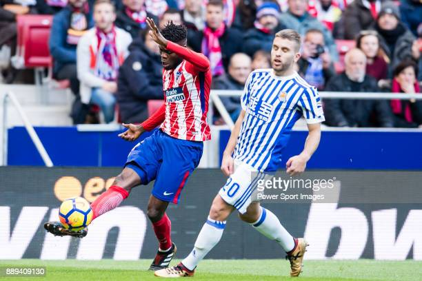Thomas Teye Partey of Atletico de Madrid fights for the ball with Kevin Rodrigues of Real Sociedad during the La Liga 201718 match between Atletico...
