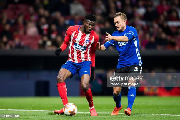 Thomas Teye Partey of Atletico de Madrid fights for the ball with Pierre Bengtsson of FC Copenhague during the UEFA Europa League 201718 Round of 32...