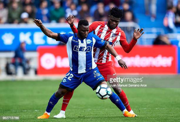 Thomas Teye Partey of Atletico Madrid duels for the ball with Wakaso Mubarak of Deportivo Alaves during the La Liga match between Deportivo Alaves...