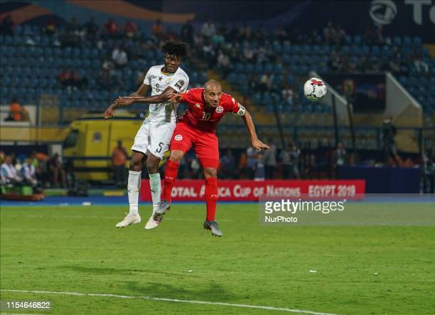 Thomas Teye Partey of Ghana and Wahbi Khazri of Tunisia challenging for the ball during the 2019 African Cup of Nations match between Ghana and...
