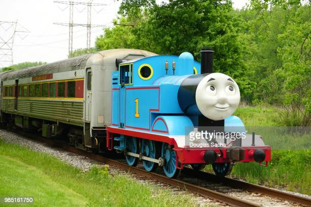 thomas the tank engine pulling a scenic train at a public park - pop up book stock pictures, royalty-free photos & images