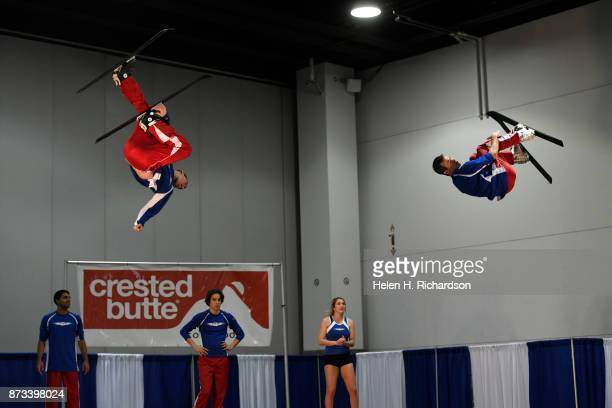 DENVER CO NOVEMBER 12 Thomas Theobald left and Kory Cross right fly high while they perform tricks with their skis on a trampoline while they...