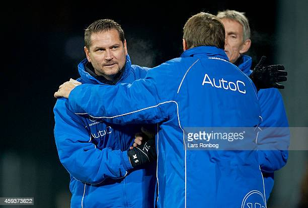 Thomas Thomasberg assistant coach of Randers FC and Colin Todd head coach of Randers FC celebrate their victory after the Danish Superliga match...
