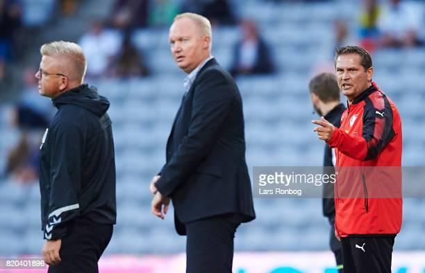 Thomas Thomasberg head coach of Hobro IK gestures against Glen Riddersholm head coach of AGF Aarhus during the Danish Alka Superliga match between...