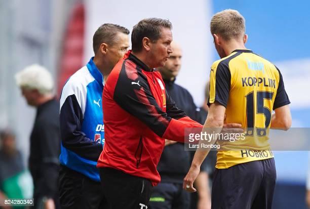 Thomas Thomasberg head coach of Hobro IK speaks to Bjorn Kopplin of Hobro IK during the Danish Alka Superliga match between FC Copenhagen and Hobro...