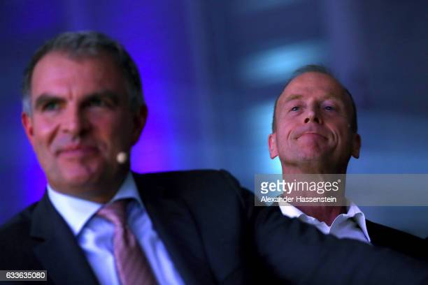 Thomas Tom Enders CEO of Airbus Group looks on with Carsten Spohr Chairman of German airline Lufthansa during a Lufthansa rollout event at Munich...