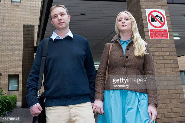 Thomas 'Tom' Hayes a former trader at banks including UBS Group AG and Citigroup Inc left and an unidentified woman leaves Southwark Crown Court...