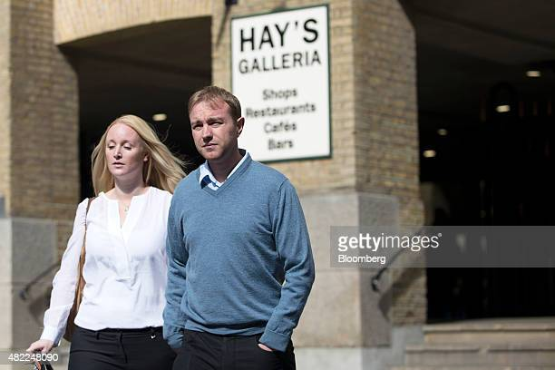 Thomas 'Tom' Hayes a former trader at banks including UBS Group AG and Citigroup Inc right and Sarah Hayes his wife arrive for his trial at Southwark...