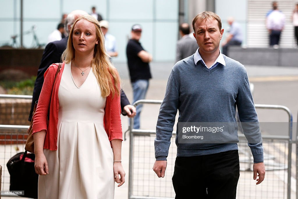 Thomas 'Tom' Hayes, a former trader at banks including UBS Group AG and Citigroup Inc., right, and his wife Sarah, leave for lunch during for his trial at Southwark Crown Court in London, U.K., on Monday, Aug. 3, 2015. Hayes, the first person to stand trial for manipulating Libor, was found guilty of eight counts of conspiracy to rig the benchmark rate. Photographer: Simon Dawson/Bloomberg via Getty Images