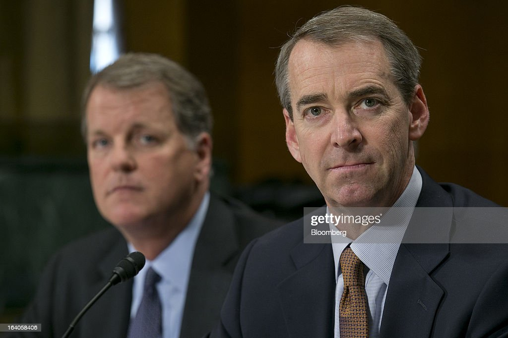 Thomas 'Tom' Horton, chairman, president and chief executive officer of AMR Corp.'s American Airlines, right, and Douglas 'Doug' Parker, chairman and chief executive officer of US Airways Group Inc., listen during a Senate Judiciary Committee hearing in Washington, D.C., U.S., on Tuesday, March 19, 2013. The proposed merger between American Airlines and US Airways would increase fares, reduce service to smaller communities and make it more difficult for low-cost carriers to compete, two consumer advocates said at a Senate hearing. Photographer: Andrew Harrer/Bloomberg via Getty Images