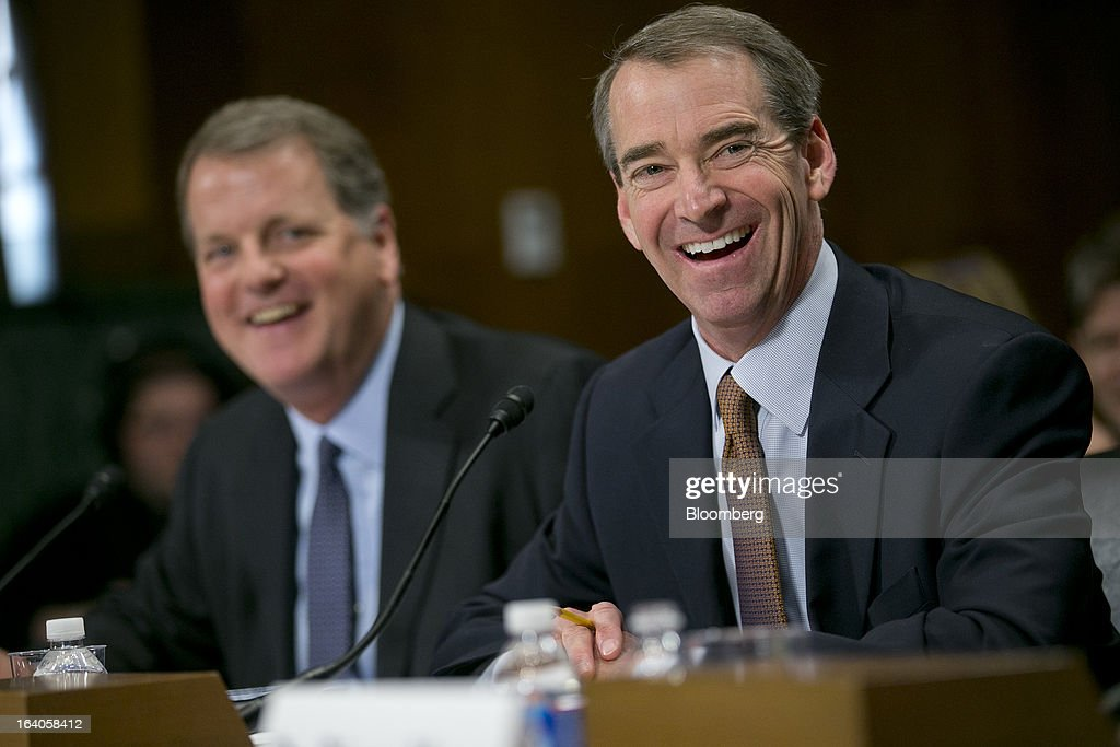 Thomas 'Tom' Horton, chairman, president and chief executive officer of AMR Corp.'s American Airlines, right, and Douglas 'Doug' Parker, chairman and chief executive officer of US Airways Group Inc., laugh during a Senate Judiciary Committee hearing in Washington, D.C., U.S., on Tuesday, March 19, 2013. The proposed merger between American Airlines and US Airways would increase fares, reduce service to smaller communities and make it more difficult for low-cost carriers to compete, two consumer advocates said at a Senate hearing. Photographer: Andrew Harrer/Bloomberg via Getty Images
