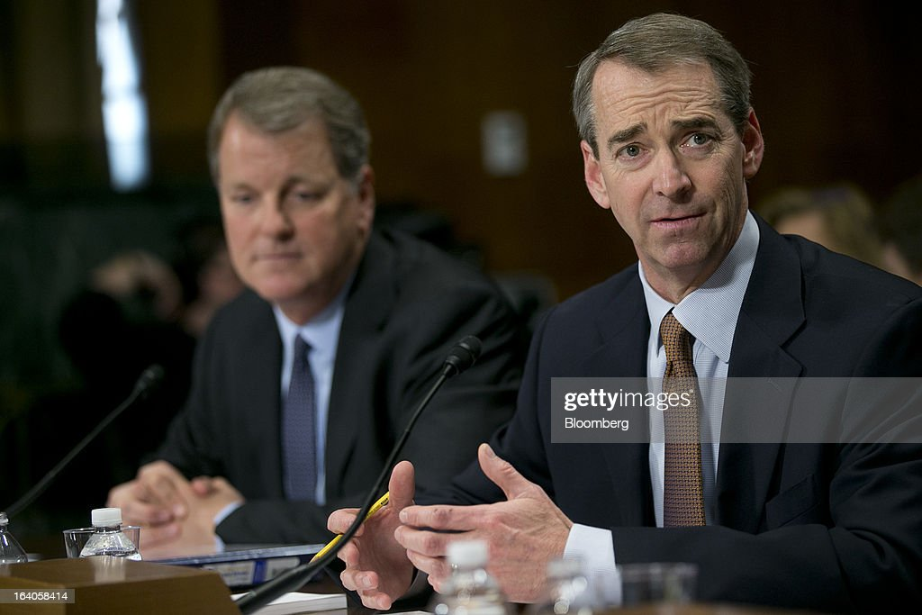 Thomas 'Tom' Horton, chairman, president and chief executive officer of AMR Corp.'s American Airlines, right, speaks during a Senate Judiciary Committee hearing with Douglas 'Doug' Parker, chairman and chief executive officer of US Airways Group Inc., in Washington, D.C., U.S., on Tuesday, March 19, 2013. The proposed merger between American Airlines and US Airways would increase fares, reduce service to smaller communities and make it more difficult for low-cost carriers to compete, two consumer advocates said at a Senate hearing. Photographer: Andrew Harrer/Bloomberg via Getty Images