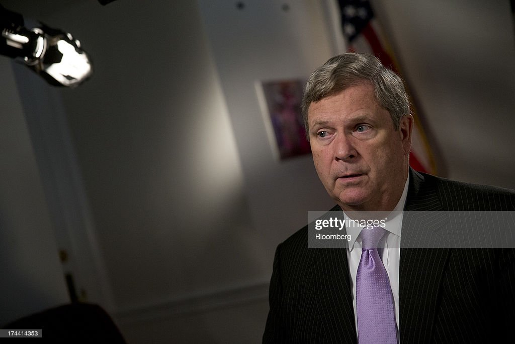 Thomas 'Tom' Vilsack, secretary of the U.S. Department of Agriculture (USDA), speaks after a Bloomberg Television interview in Washington, D.C., U.S., on Thursday, July 25, 2013. Monsanto Co. and the U.S.D.A. are investigating how genetically modified wheat that hasnt been approved for commercial use was found on an Oregon farm eight years after nationwide field tests ended. Photographer: Andrew Harrer/Bloomberg via Getty Images