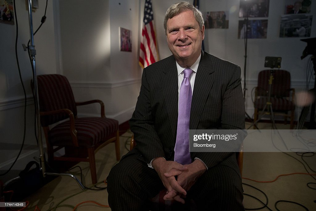 Thomas 'Tom' Vilsack, secretary of the U.S. Department of Agriculture (USDA), sits for a photograph following a Bloomberg Television interview in Washington, D.C., U.S., on Thursday, July 25, 2013. Monsanto Co. and the U.S.D.A. are investigating how genetically modified wheat that hasnt been approved for commercial use was found on an Oregon farm eight years after nationwide field tests ended. Photographer: Andrew Harrer/Bloomberg via Getty Images