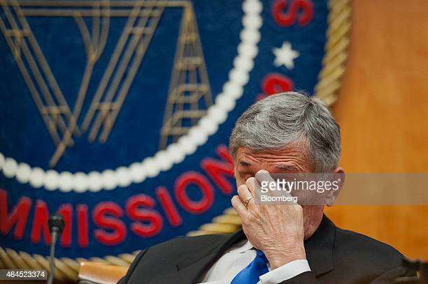 Thomas Tom Wheeler chairman of the Federal Communications Commission listens during an open meeting to vote on internet regulations in Washington DC...