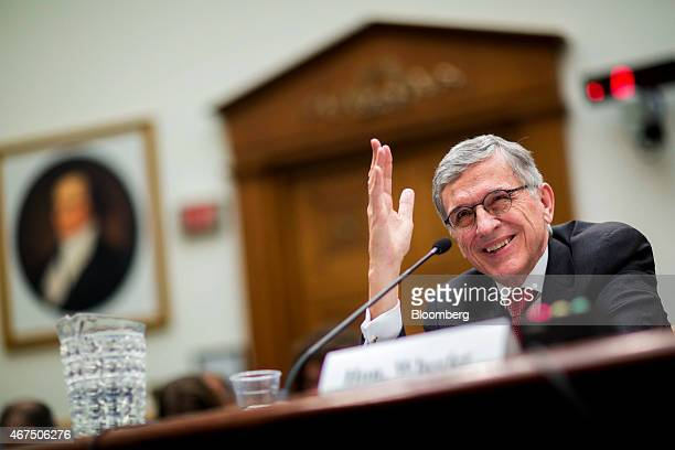 Thomas Tom Wheeler chairman of the Federal Communications Commission smiles during a House Judiciary Committee hearing in Washington DC US on...
