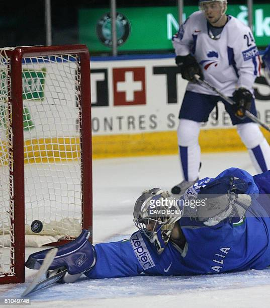 Thomas Tragust of Italy stretches in vain to stop France's second goal in the first period during the relegation round at the 2008 IIHF World...