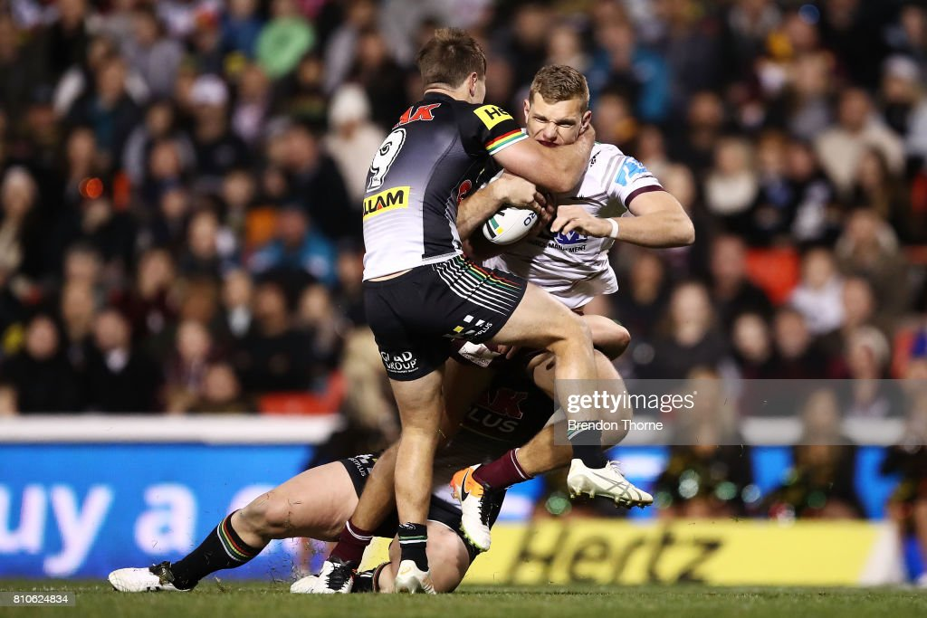 Thomas Trbojevic of the Sea Eagles is tackled by the Panthers defence during the round 18 NRL match between the Penrith Panthers and the Manly Sea Eagles at Pepper Stadium on July 8, 2017 in Sydney, Australia.