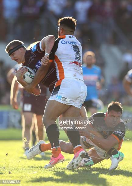 Thomas Trbojevic of the Sea Eagles is tackled during the round 19 NRL match between the Manly Sea Eagles and the Wests Tigers at Lottoland on July 16...