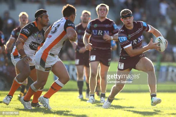 Thomas Trbojevic of the Sea Eagles runs the ball during the round 19 NRL match between the Manly Sea Eagles and the Wests Tigers at Lottoland on July...