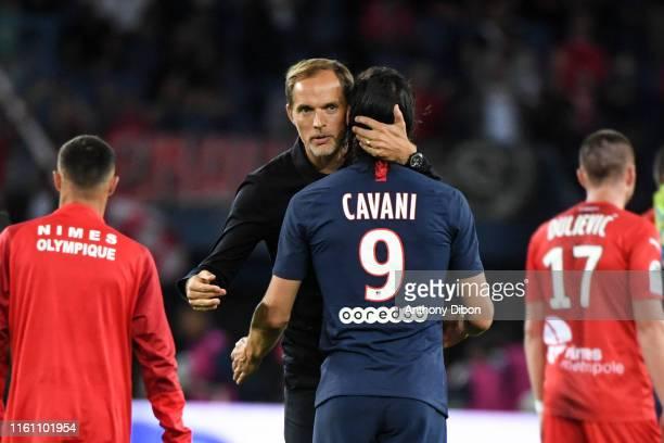 Thomas Tuchel coach of PSG and Edinson Cavani during the Ligue 1 match between Paris Saint Germain and Nimes at Parc des Princes on August 11, 2019...