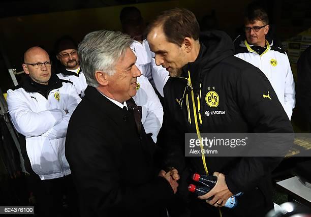 Thomas Tuchel Head Coach of Borussia Dortmund greets Carlo Ancelotti Head Coach of Bayern Munich during the Bundesliga match between Borussia...